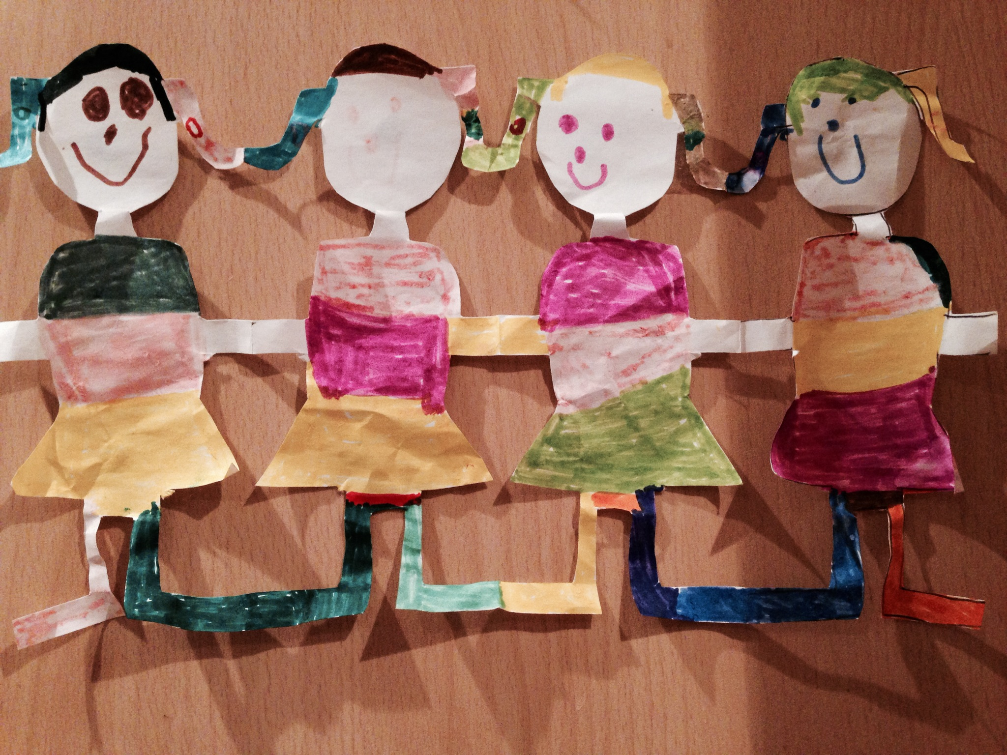 Little E's paper dolls - one of the many art works on our kitchen cupboards