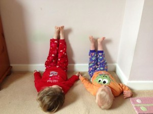 My children demonstrating legs-against-the-wall, which can help promote sleep
