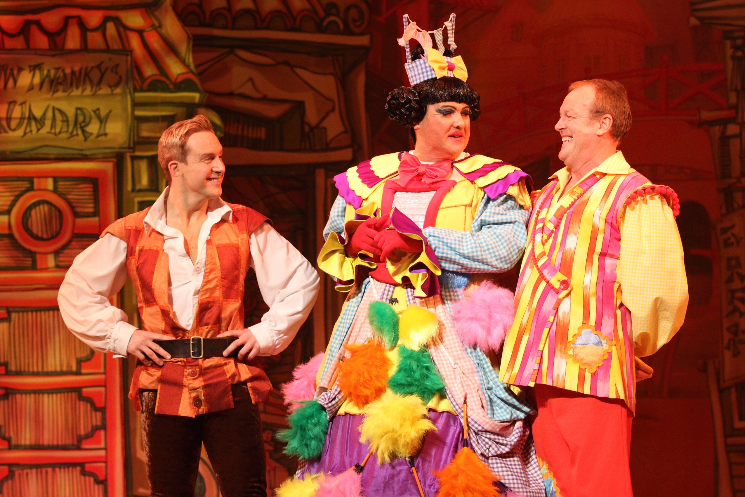 Ian H Watkins as Aladdin, Mike Doyle as Widow Twankey and Andy Jones as Wishy Washy