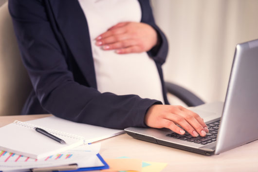 {regnant woman at work - photo from ISTOCK by GeorgeRudy
